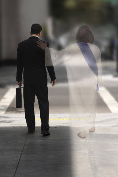 Double Exposure of a businessman walking down the street with Jesus at his side